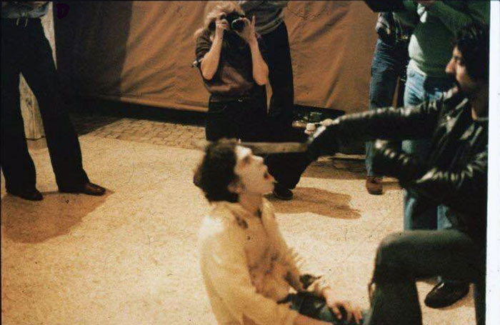Behind the scenes photo of Tom Savini shooting and Lenny Lies machete scene